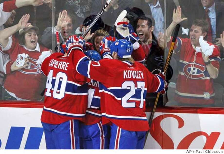 ###Live Caption:Fans help celebrate with Montreal Canadiens' Maxime Lapierre, left, and Alex Kovalev, from Russia, right, on a goal against the Boston Bruins' by teammate Mark Streit, from Switzerland, hidden, during the second period of Game 7 first round NHL Stanley Cup Playoffs on Monday, April 21, 2008 in Montreal. (AP Photo/The Canadian Press, Paul Chiasson)###Caption History:Fans help celebrate with Montreal Canadiens' Maxime Lapierre, left, and Alex Kovalev, from Russia, right, on a goal against the Boston Bruins' by teammate Mark Streit, from Switzerland, hidden, during the second period of Game 7 first round NHL Stanley Cup Playoffs on Monday, April 21, 2008 in Montreal. (AP Photo/The Canadian Press, Paul Chiasson)###Notes:Maxime Lapierre, Alex Kovalev###Special Instructions:EFE OUT Photo: Paul Chiasson