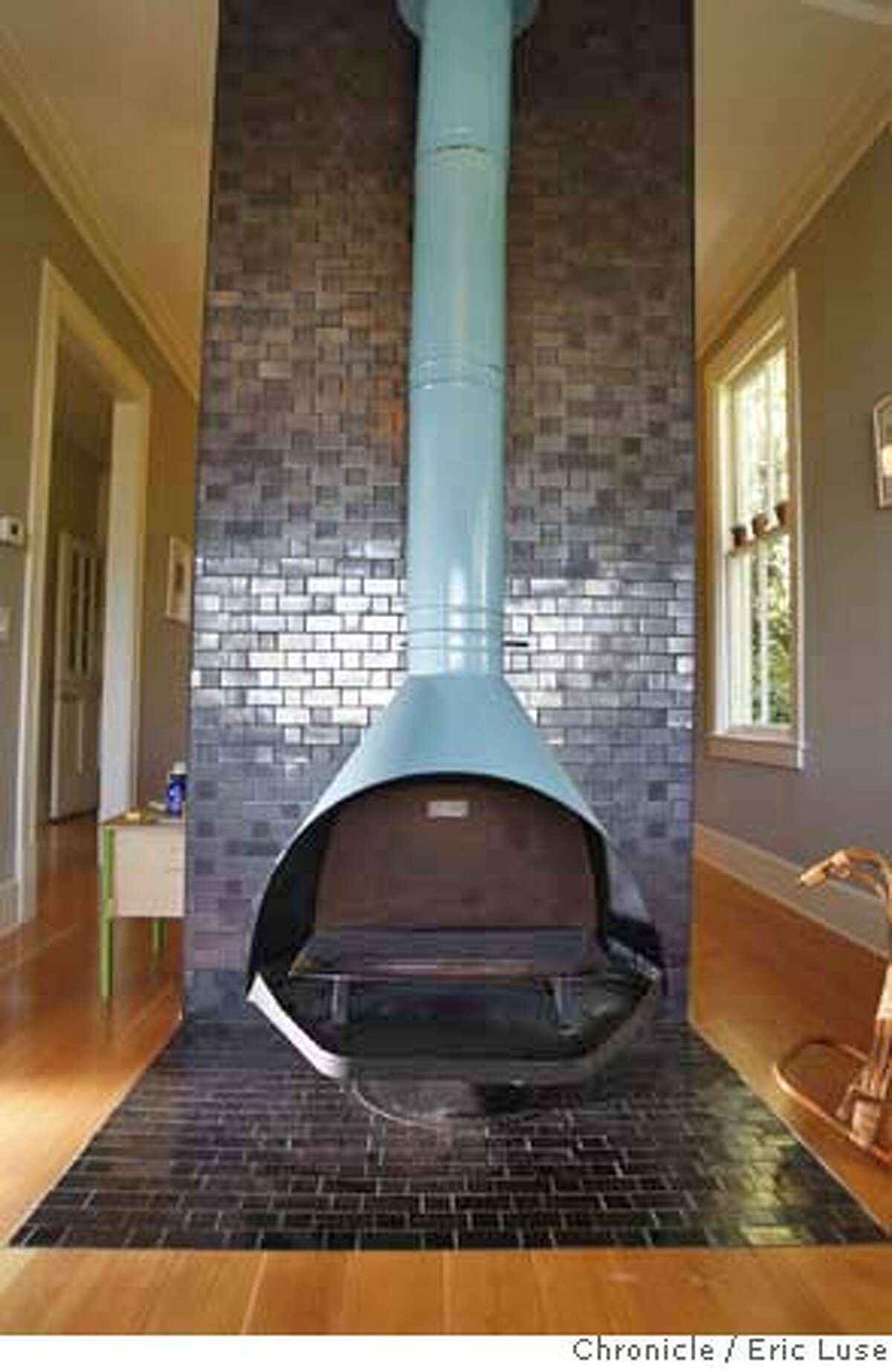 ###Live Caption:Fireplace in the home of Heath Ceramic owners Catherine Bailey and Robin Petravic's home in Sausalito photographed on Wednesday, April 16, 2008. Photo by Eric Luse / San Francisco Chronicle###Caption History:Fireplace in the home of Heath Ceramic owners Catherine Bailey and Robin Petravic's home in Sausalito photographed on Wednesday, April 16, 2008. Photo by Eric Luse / San Francisco Chronicle###Notes:Name cq by source###Special Instructions:MANDATORY CREDIT FOR PHOTOG AND SAN FRANCISCO CHRONICLE/NO SALES-MAGS OUT