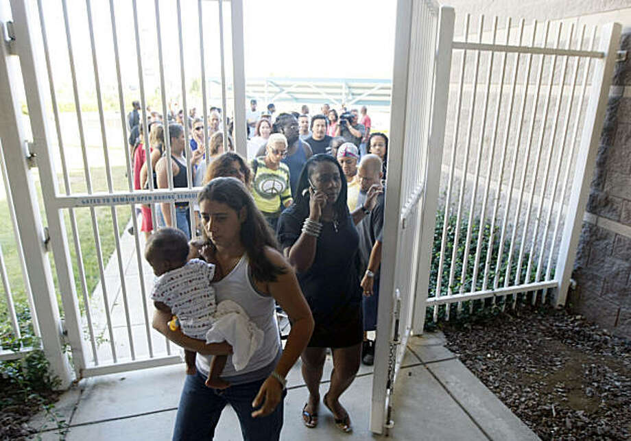 Hundreds parents and family members arrive on Deer Valley High School campus to take their teens home after a East county wide school lock down after a shooting off campus as the teens were arriving to the Antioch school Wednesday Sept 16, 2009. Photo: Lance Iversen, The Chronicle
