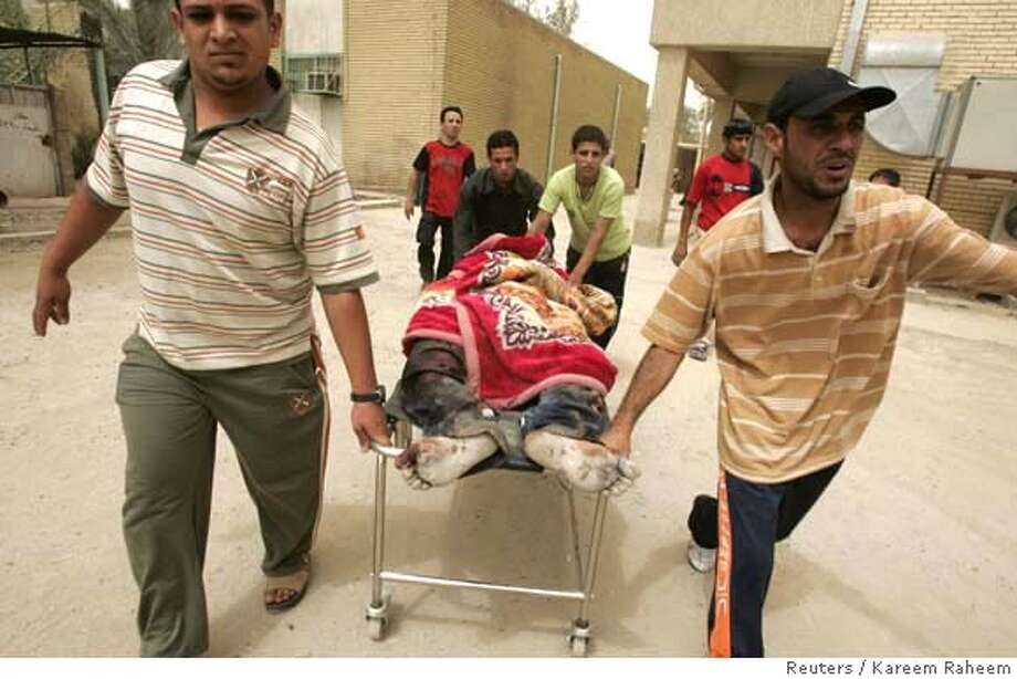 ###Live Caption:The body of a man who was recovered from the rubble of a destroyed house after an air strike is wheeled into a hospital morgue in Baghdad's Sadr City April 29, 2008. REUTERS/Kareem Raheem (IRAQ)###Caption History:The body of a man who was recovered from the rubble of a destroyed house after an air strike is wheeled into a hospital morgue in Baghdad's Sadr City April 29, 2008. REUTERS/Kareem Raheem (IRAQ)###Notes:Body of a man who was recovered from rubble of destroyed house after air strike is wheeled into hospital morgue in Baghdad's Sadr City###Special Instructions:0 Photo: KAREEM RAHEEM