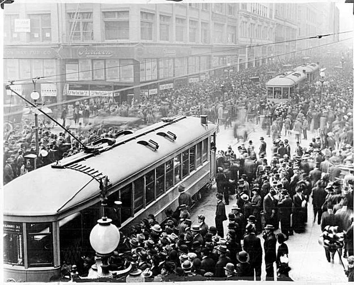 MUNI1/B/05OCT99/MN/HO--Muni streetcars at Geary and Kearny Streets on the first day, December 28, 1912.