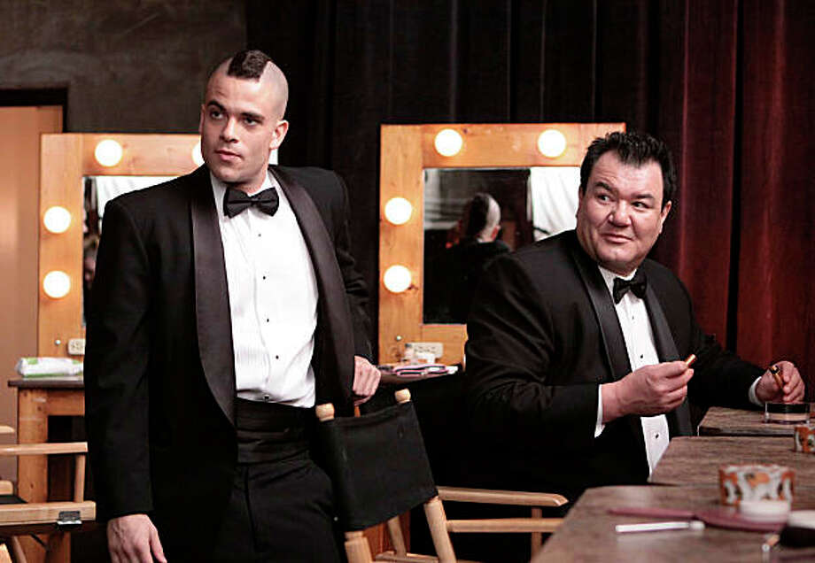 """GLEE: Puck (Mark Salling, L) and Coach Tanaka (Patrick Gallagher, R) get ready to perform at a PTA function in the """"Acafellas"""" episode of GLEE airing Wednesday, Sept. 16 (9:00-10:00 PM ET/PT) on FOX. ©2009 Fox Broadcasting Co. CR: Carin Baer/FOX Photo: Fox / SFC"""