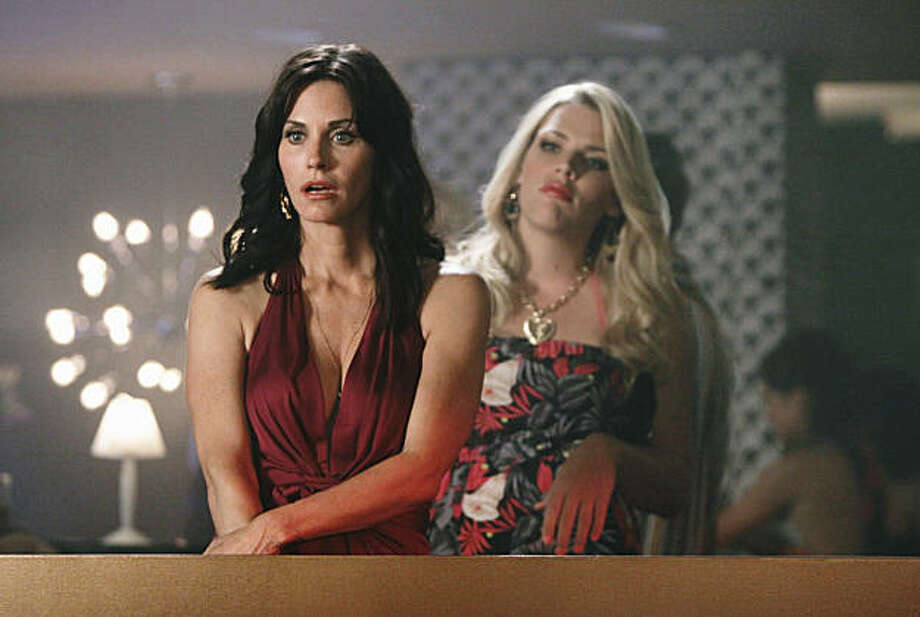 "COUGAR TOWN - Courteney Cox stars as a recently divorced single mother exploring the honest truths about dating and aging in our beauty and youth obsessed culture. ""Cougar Town"" stars Courteney Cox as Jules, Christa Miller as Elle, Busy Philipps as Laurie, Dan Byrd as Travis, Brian Van Holt as Bobby, Josh Hopkins as Grayson and Ian Gomez as Andy. The series is from ABC Studios. Bill Lawrence is executive producer/writer/director, Kevin Biegel is writer/co-executive producer, and Courteney Cox and David Arquette are executive producers. (ABC/MICHAEL DESMOND) COURTENEY COX, BUSY PHILIPPS Photo: Michael Desmond, ABC"