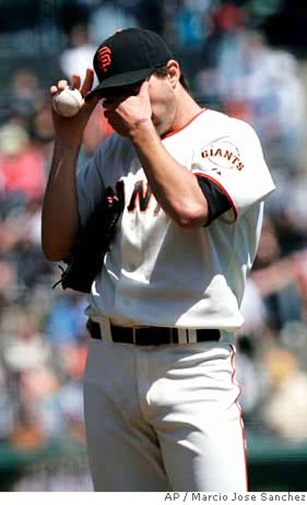 San Francisco Giants starter Barry Zito reacts after loading up the bases against the Arizona Diamondbacks in the first inning of a baseball game in San Francisco, Wednesday, April 16, 2008. Arizona won 4-1. (AP Photo/Marcio Jose Sanchez)