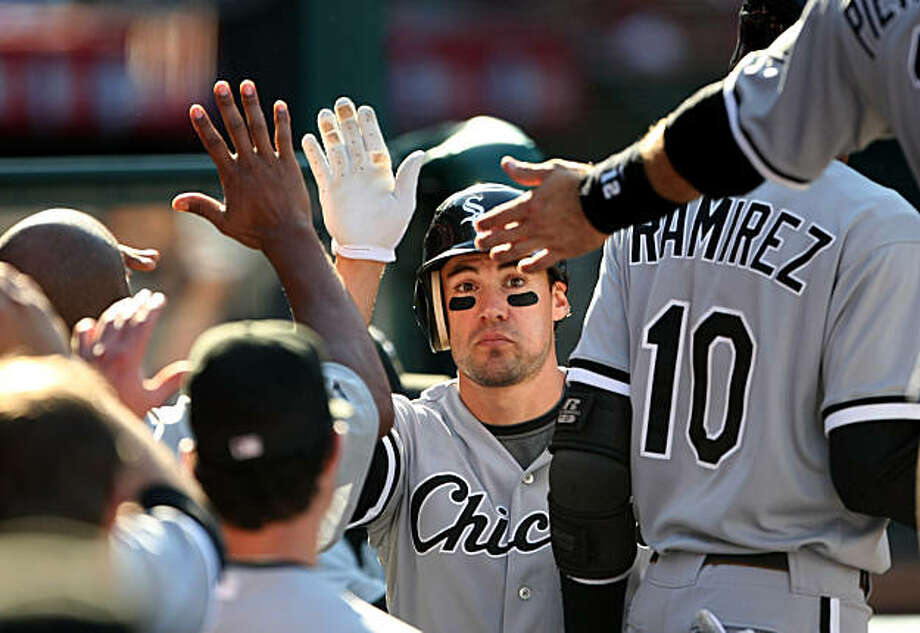 ANAHEIM, CA - SEPTEMBER 12:  Scott Podsednik #22 of the Chicago White Sox is greeted in the dugout after scoring the eventual winning run on a wild pitch in the 10th inning against the Los Angeles Angels of Anaheim on September 12, 2009 at Angel Stadium in Anaheim, California.  The White Sox won 4-3 in 10 innings.  (Photo by Stephen Dunn/Getty Images) Photo: Stephen Dunn, Getty Images