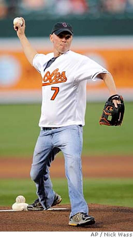 ###Live Caption:Kenny Chesney must have gotten word about the Malibu dress code: It's baseball caps, dude, not cowboy hats.###Caption History:Country music star Kenny Chesney throws out the ceremonial first pitch before a baseball game between the Baltimore Orioles and Chicago Thursday, April 17, 2008, in Baltimore. (AP Photo/Nick Wass)###Notes:Kenny Chesney###Special Instructions:EFE OUT Photo: Nick Wass