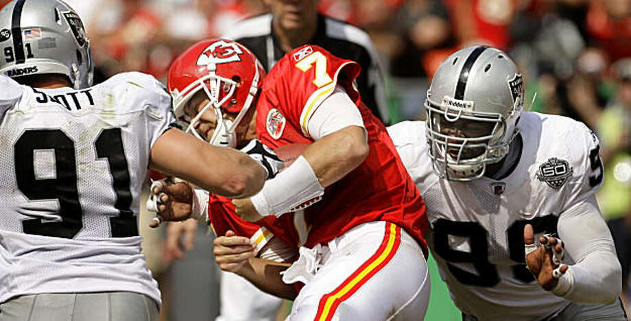 Kansas City Chiefs quarterback Matt Cassel (7) is sacked by Oakland Raiders defensive end Greg Ellis (99) while pressured by defensive tackle Trevor Scott (91) during the fourth quarter of a NFL football game Sunday, Sept. 20, 2009 in Kansas City, Mo. The Raiders won the game 13-10. (AP Photo/Charlie Riedel) Photo: Charlie Riedel, AP