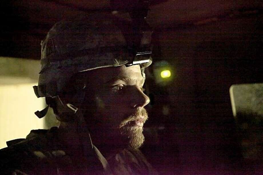 In this photo taken Monday, Sept. 21, 2009, Spc. Steven Thorn from Columbus, Ohio, from the U.S. Army's 3rd Battalion, 509th Infantry Regiment (Airborne), based at Fort Richardson, Alaska, sits in an armored vehicle during a night mission in Zerok district, East Paktika province in Afghanistan. (AP Photo/Dima Gavrysh) Photo: Dima Gavrysh, AP
