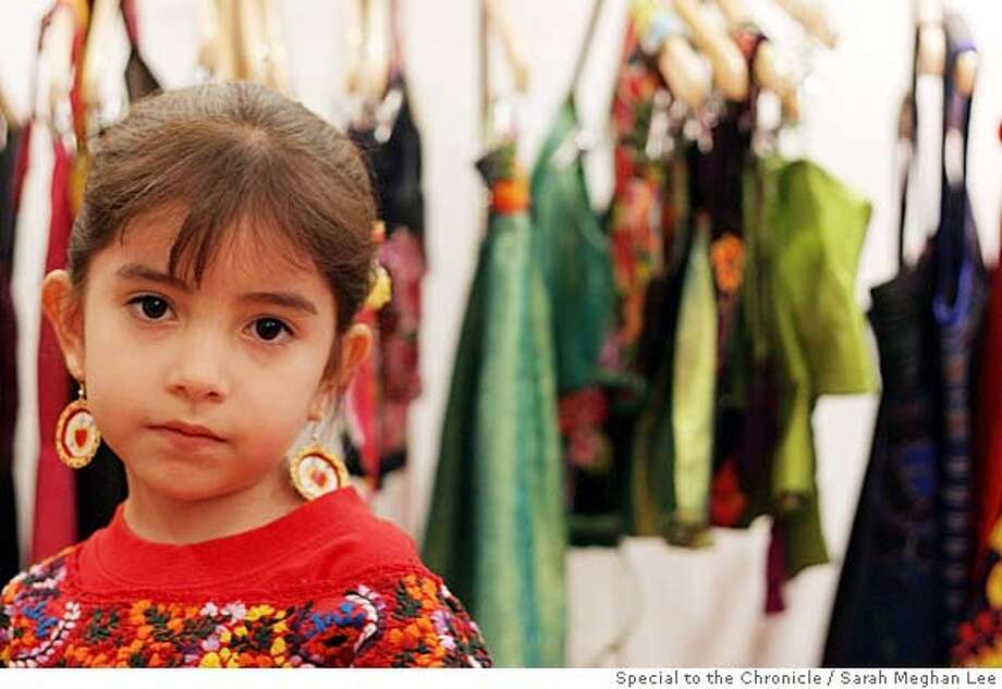 ###Live Caption:Maria del Carmen Gavito, 6, helps her mother sell clothes in the Fosado sister's clothing store in the Bazar Sabado building on Plaza San Jacinto in San Angel, Mexico City on March 29, 2008. (Photo By Sarah Meghan Lee) Photo By Sarah Meghan Lee / ###Caption History:Maria del Carmen Gavito, 6, helps her mother sell clothes in the Fosado sister's clothing store in the Bazar Sabado building on Plaza San Jacinto in San Angel, Mexico City on March 29, 2008. (Photo By Sarah Meghan Lee) Photo By Sarah Meghan Lee / ###Notes:SAN ANGEL MEXICO TRAVEL###Special Instructions:MANDATORY CREDIT FOR PHOTOG AND SAN FRANCISCO CHRONICLE. NO SALES- MAGS OUT. Photo: Sarah Meghan Lee