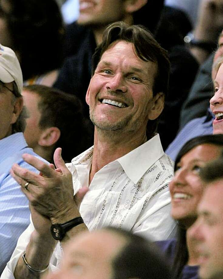 "In this May 23, 2008 file photo, actor Patrick Swayze watches the Los Angeles Lakers and San Antonio Spurs play in the first half in Game 2 of the NBA Western Conference basketball finals in Los Angeles. Swayze's publicist Annett Wolf says the 57-year-old ""Dirty Dancing"" actor died Monday, Sept. 14, 2009, after a nearly two-year battle with pancreatic cancer. Photo: Mark J. Terrill, AP"