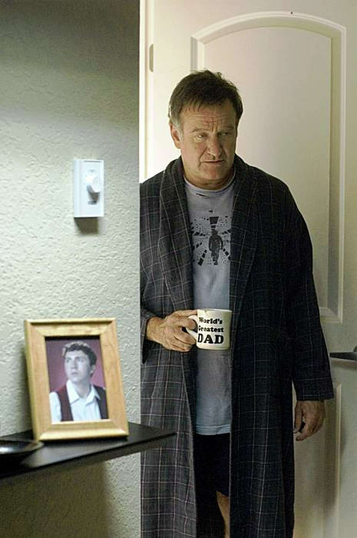 In this film publicity image released by Magnolia Pictures, Robin Williams is shown in a scene from
