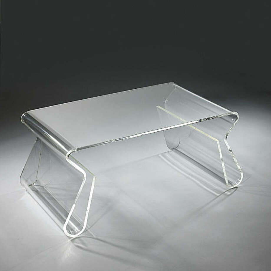 For a story on living in small spaces: With magazine racks integrated into the sides, the acrylic piece – designed by Karim Rashid for Umbra(umbra.com) – does double duty. Photo: Courtesy Umbra, Courtesy Brookstone