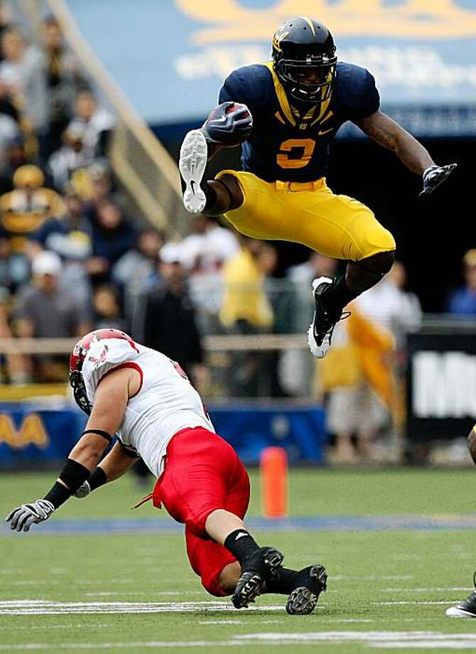 BERKELEY, CA - SEPTEMBER 12: Jeremy Ross #3 of the California Golden Bears jumps over Kyle Wilkins #7 of the Eastern Washington Eagles on a punt return at Memorial Stadium on September 12, 2009 in Berkeley, California.  (Photo by Jed Jacobsohn/Getty Images) Photo: Jed Jacobsohn, Getty Images