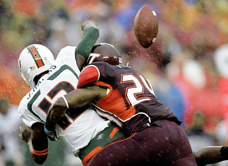 Virginia Tech defender Dorian Porch (24) sacks Miami quarterback Jacory Harris (12) as he fumbles the ball during the first half of an NCAA college football game at Lane Stadium in Blacksburg, Va., Saturday Sept 26, 2009.  (AP Photo/Steve Helber) Photo: Steve Helber, AP