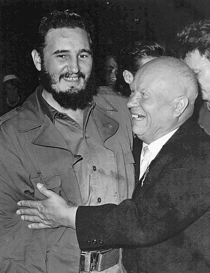 Cuban leader Fidel Castro, left, is hugged by Soviet Premier Nikita S. Khrushchev on the floor of the United Nations General Assemby in this September 1960 file photo. Castro, who has defiantly forged a Communist state in America's backyard and has weathered the hostility of every U.S. administration since Eisenhower, turns 70 on Tuesday Aug. 13, 1996.  (AP Photo/Marty Lederhandler) Photo: Marty Lederhandler, AP