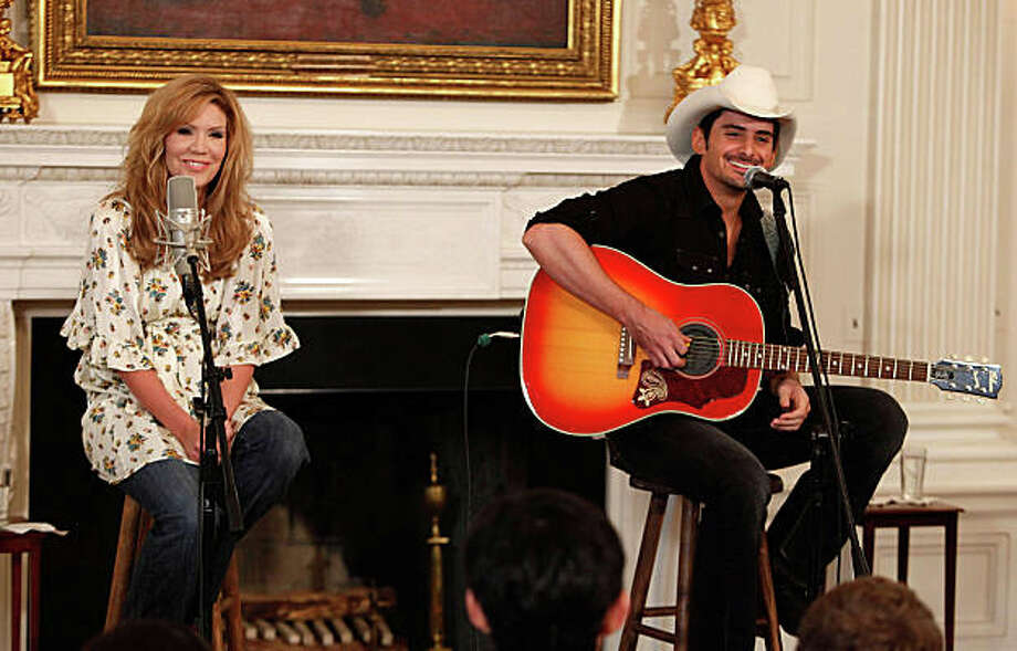WASHINGTON - JULY 21:  Country music stars Alison Krauss (L) and Brad Paisley participate in a music workshop at the White House July 21, 2009 in Washington, DC.The White House hosted the workshop celebrating country music as part of a music series.  (Photo by Mark Wilson/Getty Images) Photo: Mark Wilson, Getty Images / Getty Images North America