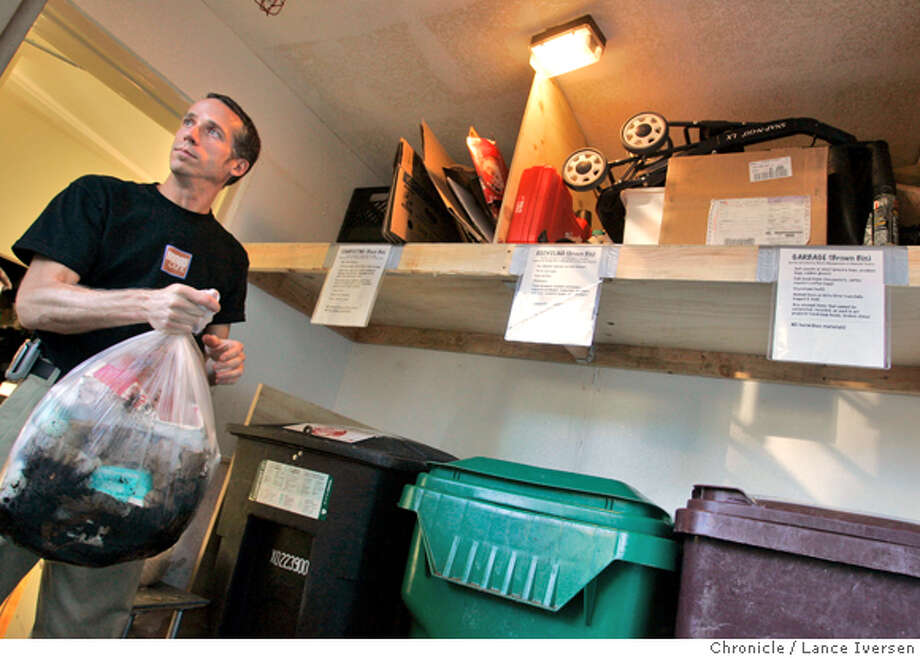 """NOMAD12122.jpg_  Nomad Cafe owner Christopher Waters recycles almost everything in bens in the rear of the cafe. Oakland's Nomad Cafe is one of 10 businesses across the state to win the coveted """"WRAP of the Year"""" award, California's highest environmental honor. The restuarant sends an amazing 95 percent of its waste to recycling or composting, making it one of the greenest businesses in the state.  By Lance Iversen/San Francisco Chronicle Photo: Lance Iversen"""