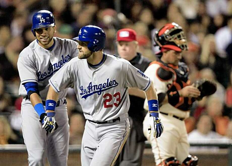 Dodgers Casey Blake crosses home plate with James Loney (left) after hitting a two run homer off Giants pitcher Matt Cain in the 6th inning at AT&T Park in San Francisco, Calif., on September 11, 2009. Photo: Frederic Larson, The Chronicle