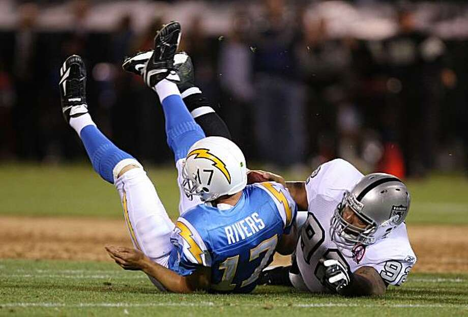 Richard Seymour (92) of the Oakland Raiders sacks Philip Rivers (17) of the San Diego Chargers. Photo: Ezra Shaw, Getty Images