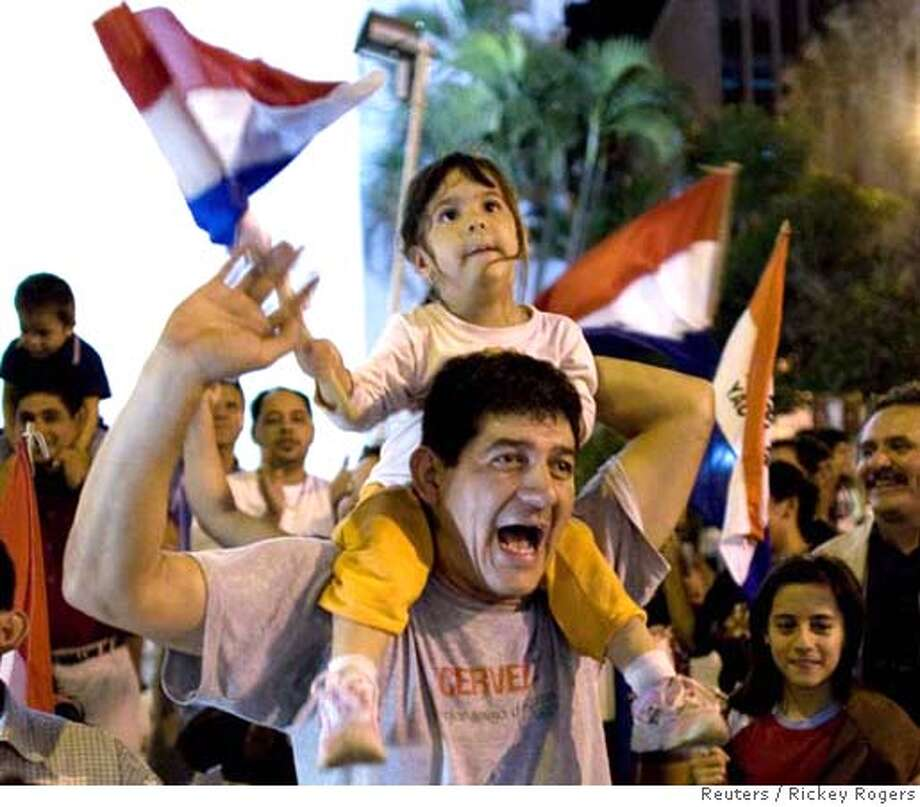 Paraguayan supporters of presidential candidate Fernando Lugo celebrate in Asuncion Photo: RICKEY ROGERS