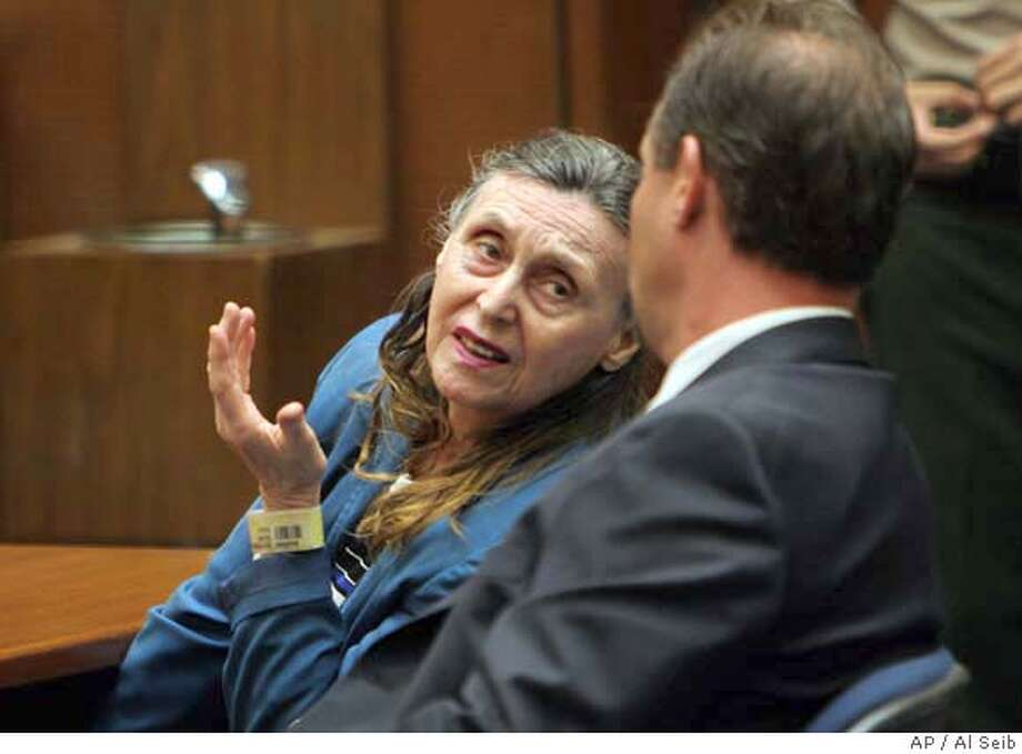 ###Live Caption:Olga Rutterschmidt, 75, talks to her attorney Michael Sklar, right, as a jury gave Los Angeles prosecutors an across-the-board win in her case Monday April 21, 2008. Rutterschmidt, was convicted of first-degree murder and conspiracy to murder for financial gain in the death of Paul Vados, 73. Last week, she was convicted of murder and conspiracy in the death of Kenneth McDavid, 50. (AP Photo/Al Seib,Pool)###Caption History:Olga Rutterschmidt, 75, talks to her attorney Michael Sklar, right, as a jury gave Los Angeles prosecutors an across-the-board win in her case Monday April 21, 2008. Rutterschmidt, was convicted of first-degree murder and conspiracy to murder for financial gain in the death of Paul Vados, 73. Last week, she was convicted of murder and conspiracy in the death of Kenneth McDavid, 50. (AP Photo/Al Seib,Pool)###Notes:Olga Rutterschmidt###Special Instructions: Photo: Al Seib