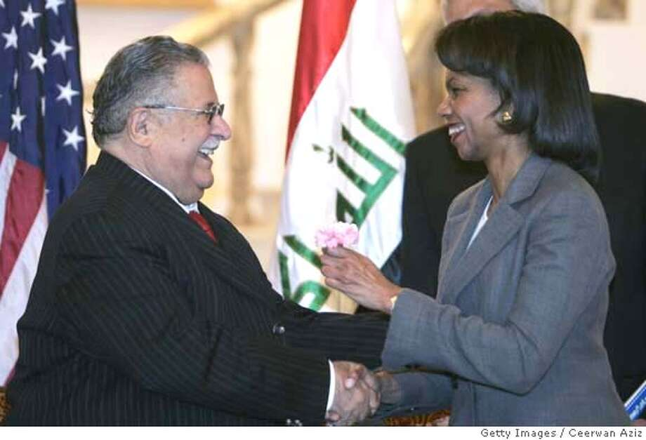 ###Live Caption:BAGHDAD - APRIL20: Iraqi President Jalal Talabani shakes hands with U.S. Secretary of State Condoleezza Rice after giving her a flower during their meeting April 20, 2008 in Baghdad, Iraq. during their meeting Rice praised assaults on radical militias led by the government. (Photo by Ceerwan Aziz-Pool/Getty Images)###Caption History:BAGHDAD - APRIL20: Iraqi President Jalal Talabani shakes hands with U.S. Secretary of State Condoleezza Rice after giving her a flower during their meeting April 20, 2008 in Baghdad, Iraq. during their meeting Rice praised assaults on radical militias led by the government. (Photo by Ceerwan Aziz-Pool/Getty Images)###Notes:U.S. Secretary of State Condoleezza Rice Visits Baghdad###Special Instructions: Photo: Pool