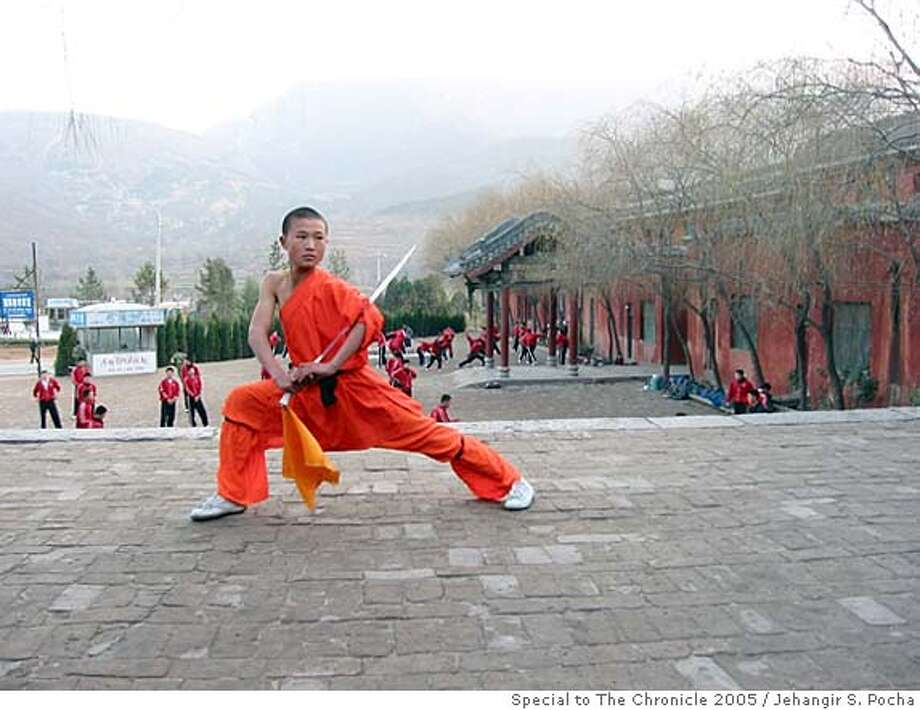 CHINA_SHAOLIN.JPG Cai Qing Bin, 13, training in the shadow of the Shaoshi mountains in the courtyard of the Shaolin school. Jehangir S. Pocha/ Special to Chronicle Ran on: 10-09-2005  Cai Qing Bin, 13, one of 10,000 students training in the courtyard of Shaolin Temple, in the shadow of China's Shaoshi mountains.  Ran on: 04-20-2008  A name you can trust: Presumably more profitable than the Health Valley Death Center. Submit your unintentionally funny sign photos to www.signspotting.com. (Do not send them to The Chronicle.) If we use one, you will receive $50 plus the chance to win an around-the-world ticket. Photo: Jehangir S. Pocha