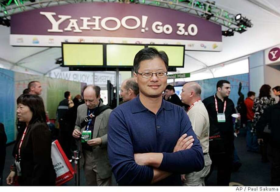 ###Live Caption:Yahoo CEO Jerry Yang and his company's board are facing what might be their most important deadline. Microsoft Corp. has vowed to take the next step in its three-month merger fight for the Sunnyvale Web portal if it fails to have an acquisition agreement on the table by today###Caption History:** FILE ** Yahoo CEO Jerry Yang poses for a photo in front of the Yahoo booth at the Consumer Electronics Show in Las Vegas in this Jan. 7, 2008 file photo. Internet icon Yahoo Inc., under pressure of a three-week deadline from Microsoft to accept its $41 billion buyout bid, on Monday, April 7, 2008 said it doesn't oppose a deal with the world's largest software maker but wants a better offer. (AP Photo/Paul Sakuma, file)###Notes:###Special Instructions:JAN 7, 2008 FILE PHOTO. Photo: Paul Sakuma