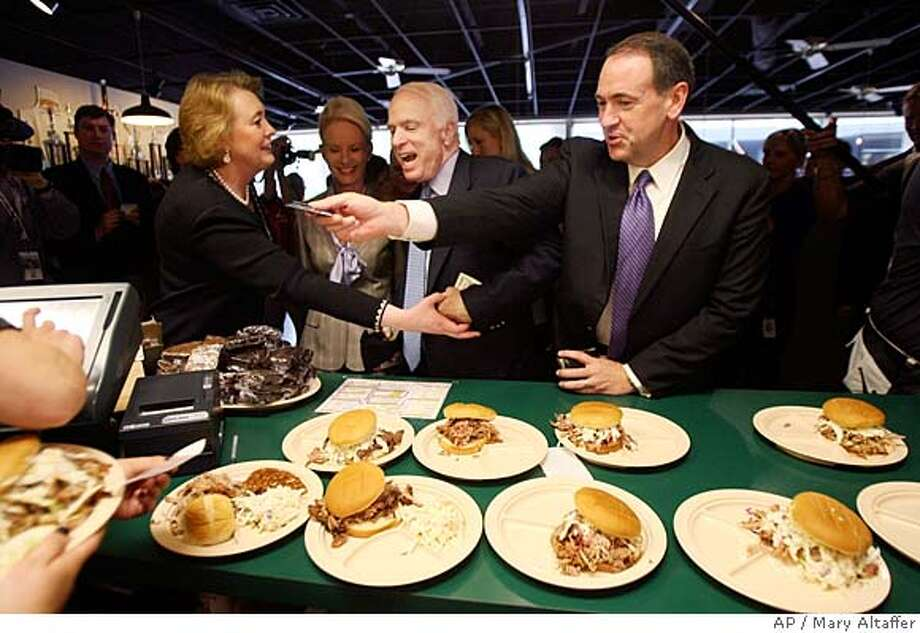 ###Live Caption:Republican presidential candidate, Sen. John McCain, R-Ariz., center, former Arkansas Gov. Mike Huckabee, right, and his wife Janet, argue over who will pay for barbeque at Whole Hog Cafe in Little Rock, Ark. McCain's wife Cindy is second from left. (AP Photo/Mary Altaffer)###Caption History:Republican presidential candidate, Sen. John McCain, R-Ariz., center, former Arkansas Gov. Mike Huckabee, right, and his wife Janet, argue over who will pay for barbeque at Whole Hog Cafe in Little Rock, Ark. McCain's wife Cindy is second from left. (AP Photo/Mary Altaffer)###Notes:John McCain, Mike Huckabee, Janet Huckabee, Cindy McCain###Special Instructions: Photo: Mary Altaffer