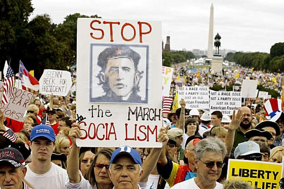 Demonstrators protest on Capitol Hill in Washington, Saturday, Sept. 12, 2009, during a taxpayer rally. The Washington Monument is in the background. Photo: Jose Luis Magana, AP