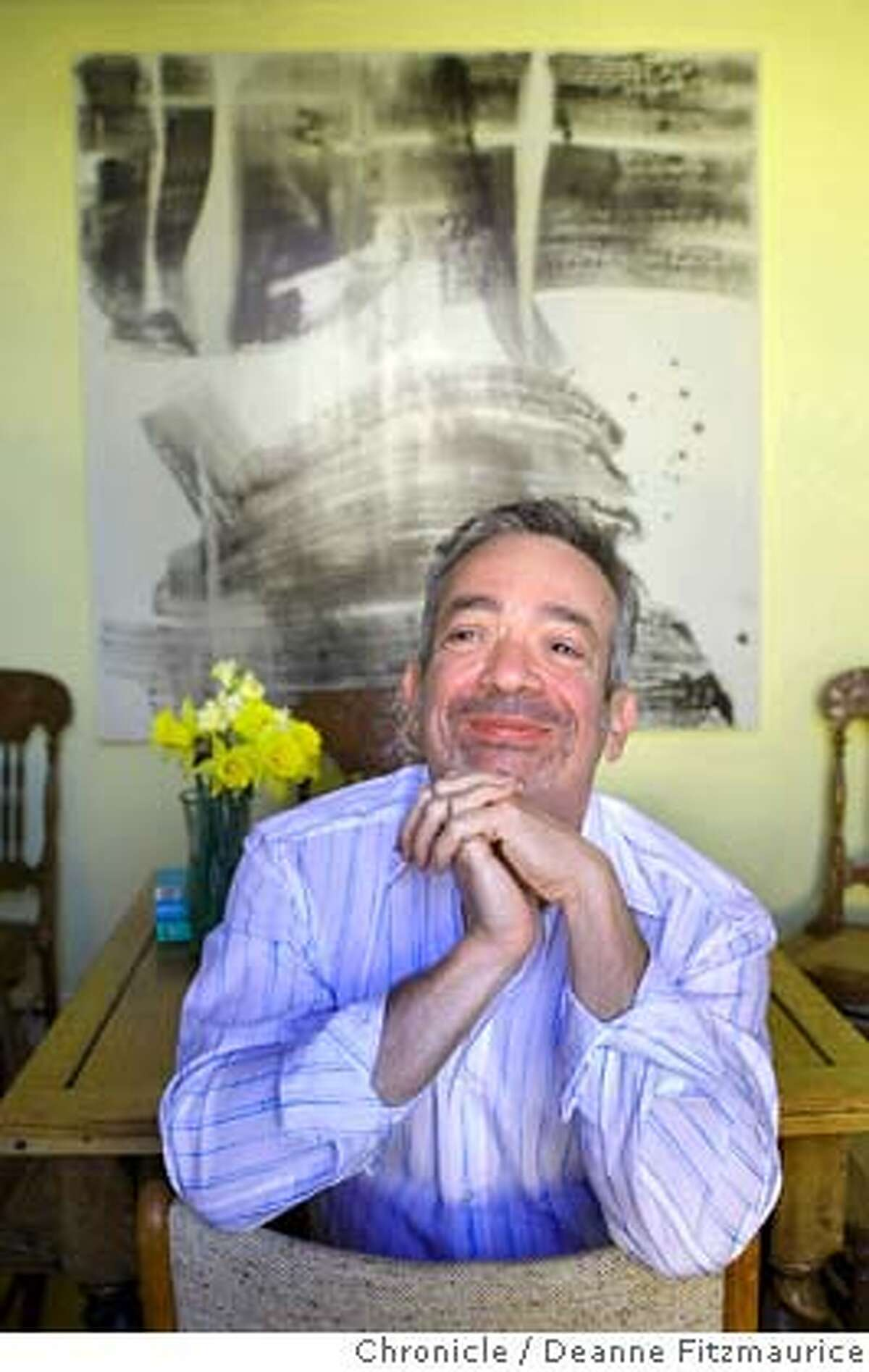 Author Rabih Alameddine is at his home in front of his paintings on April 15, 2008 in San Francisco, Calif. Deanne Fitzmaurice / The Chronicle