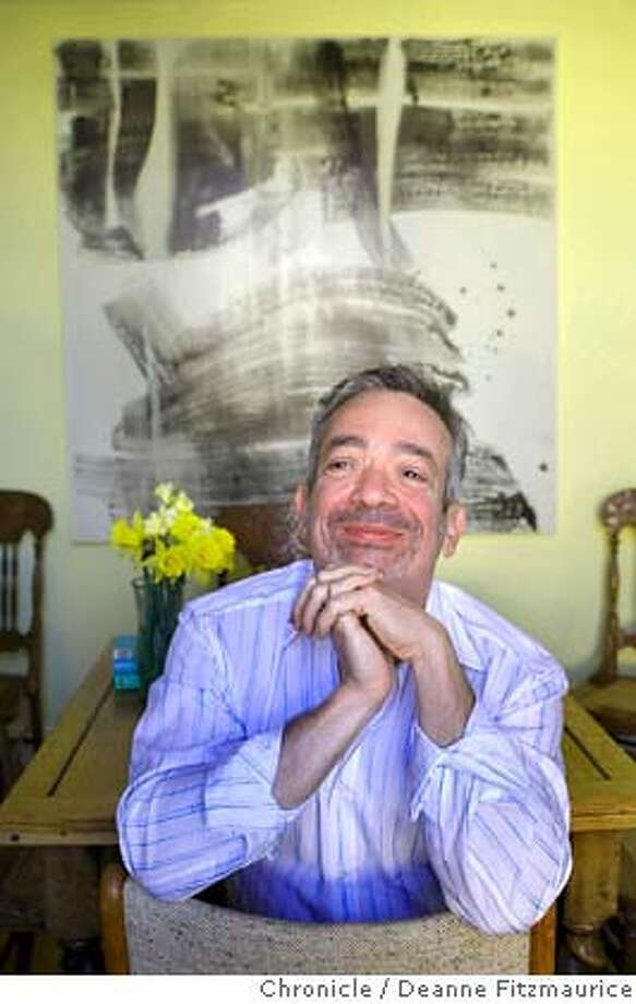 Author Rabih Alameddine is at his home in front of his paintings on April 15, 2008 in San Francisco, Calif.  Deanne Fitzmaurice / The Chronicle Photo: Deanne Fitzmaurice