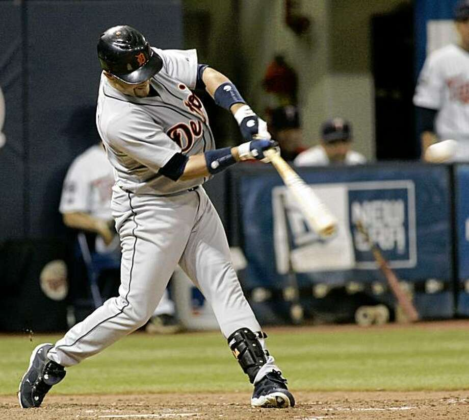 Detroit Tigers' Placido Polanco connects for a two-run single off Minnesota Twins starting pitcher Scott Baker during the fifth inning of a baseball game, Sunday, Sept. 20, 2009 in Minneapolis. Palanco was 2 for 4 on the day with three RBIs as the Tigers won 6-2. (AP Photo/Paul Battaglia) Photo: Paul Battaglia, AP