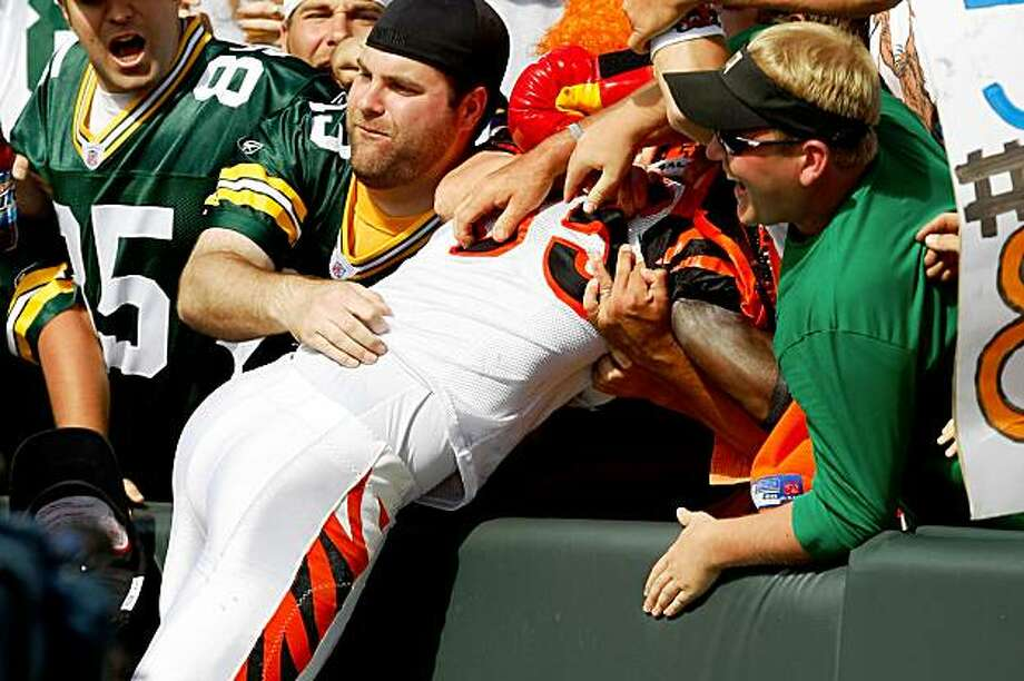 GREEN BAY, WI - SEPTEMBER 20: Wide receiver Chad Ochocinco #85 of the Cincinnati Bengals jumps in the stands to celebrate a touchdown as he does the Lambeau Leap against the Green Bay Packers at Lambeau Field on September 20, 2009 in Green Bay, Wisconsin. The Bengals defeated the Packers 31-24. (Photo by Scott Boehm/Getty Images) Photo: Scott Boehm, Getty Images