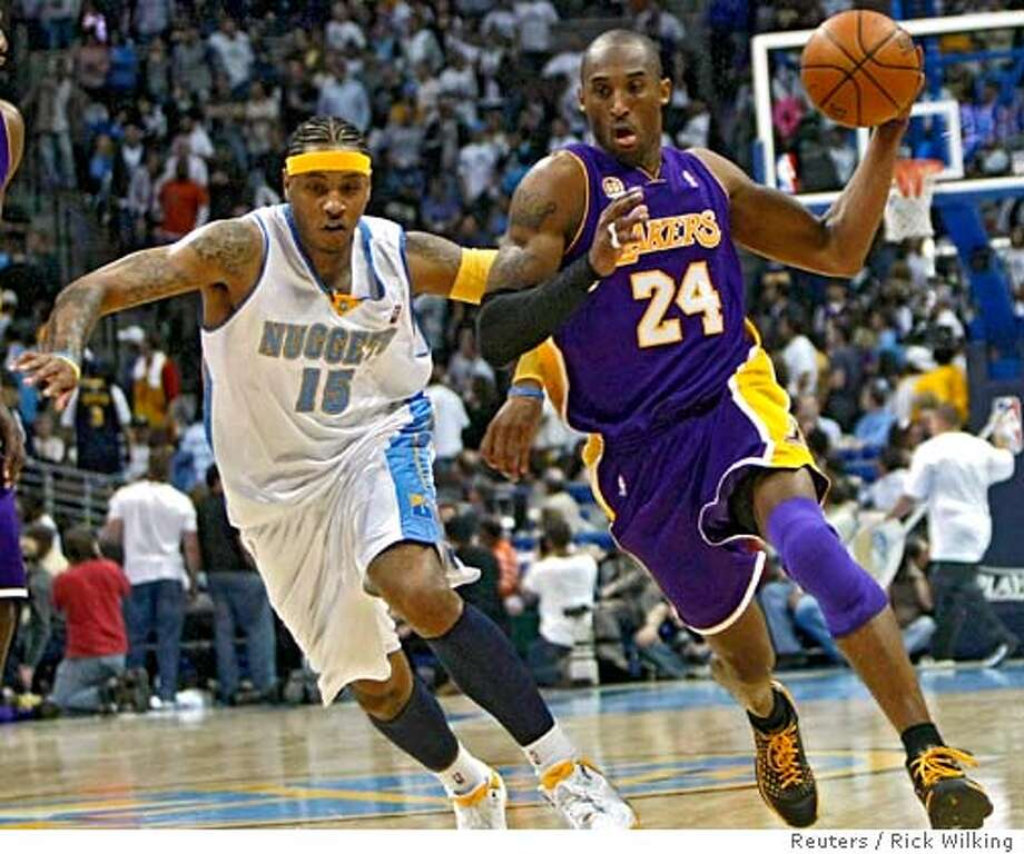 Los Angeles Lakers Kobe Bryant (R) takes off on a fast break past Denver Nuggets Carmelo Anthony during Game 3 of their NBA playoff series in Denver, Colorado April 26, 2008. REUTERS/Rick Wilking (UNITED STATES) Photo: RICK WILKING