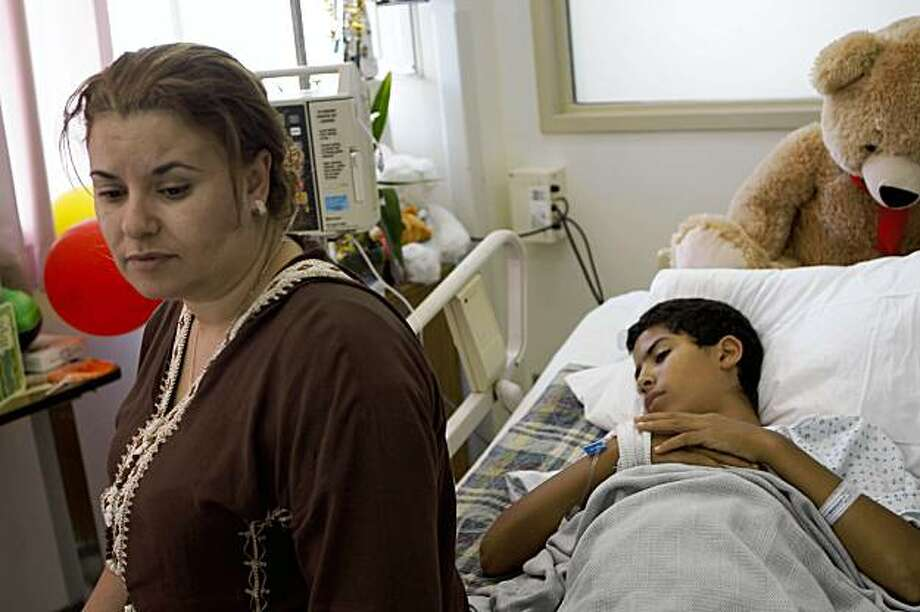 Laila Elfazouzi (left) sits with her son Hatim Mansori (right), 11 years old, at General Hospital  in San Francisco, Calif. on Tuesday, September 8, 2009 where he is recovering after he was stabbed while riding home on the bus alone for the first time. Photo: Lea Suzuki, The Chronicle