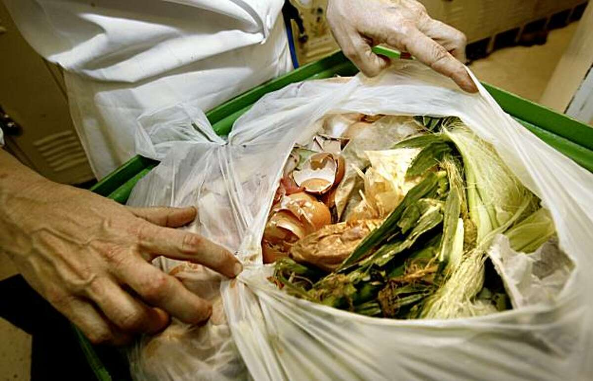 Chef Pamela Mazzola of Boulevard holds up some of their food and paper waste which is packed in corn-based plastic bags for pickup from the restaurant. San Francisco restaurants now have mandatory composting rules. Boulevard Restaurant, on Mission Street near the Embarcadero, has been doing it for years.