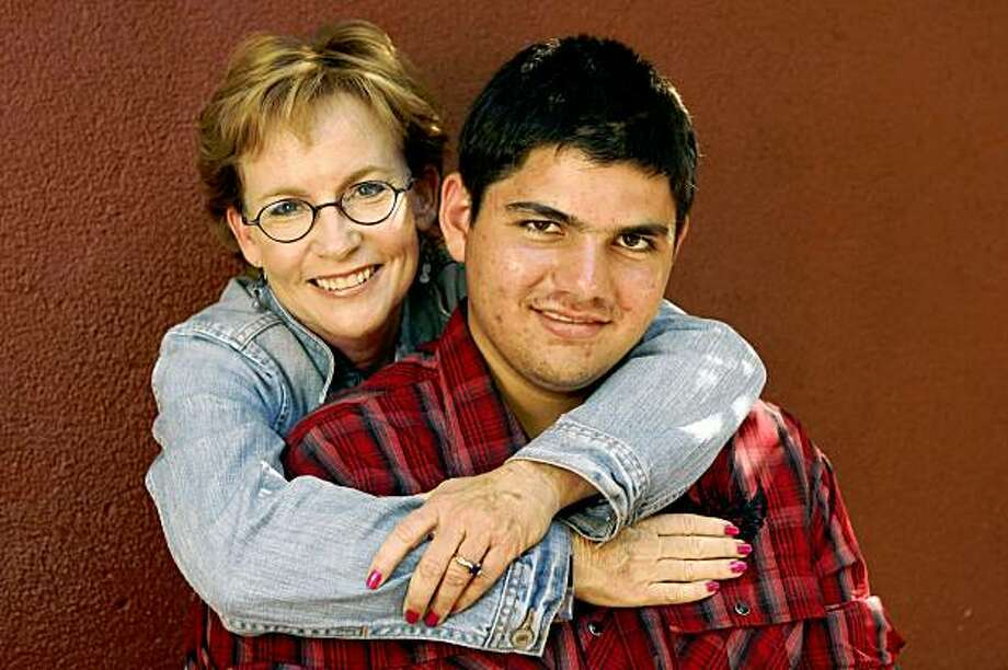 Author Joan Ryan hugs her son Ryan in the courtyard of their Marin County home. Ryan's new book deals with her son's skateboard accident and long recovery after a head injury that he continues to struggle with, as he makes plans to attend college in the fall on the east Coast. Aug 21, 2009 Photo: Lance Iversen, The Chronicle