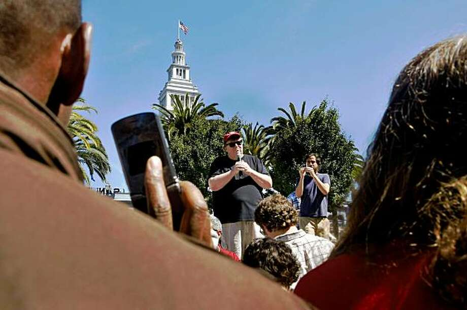 "Members of the crowd record and photograph Michael Moore with their cellphones as he speaks about his new movie ""Capitalism: A Love Story"" in Justin Herman Plaza, Thursday Sept. 17, 2009, in San Francisco, Calif. Photo: Lacy Atkins, The Chronicle"