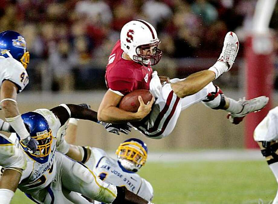 SAN FRANCISCO - SEPTEMBER 19:  Andrew Luck #12 of the Stanford Cardinal goes airborne during their game against the San Jose State Spartans at Stanford Stadium on September 19, 2009 in Palo Alto, California.  (Photo by Ezra Shaw/Getty Images) Photo: Ezra Shaw, Getty Images