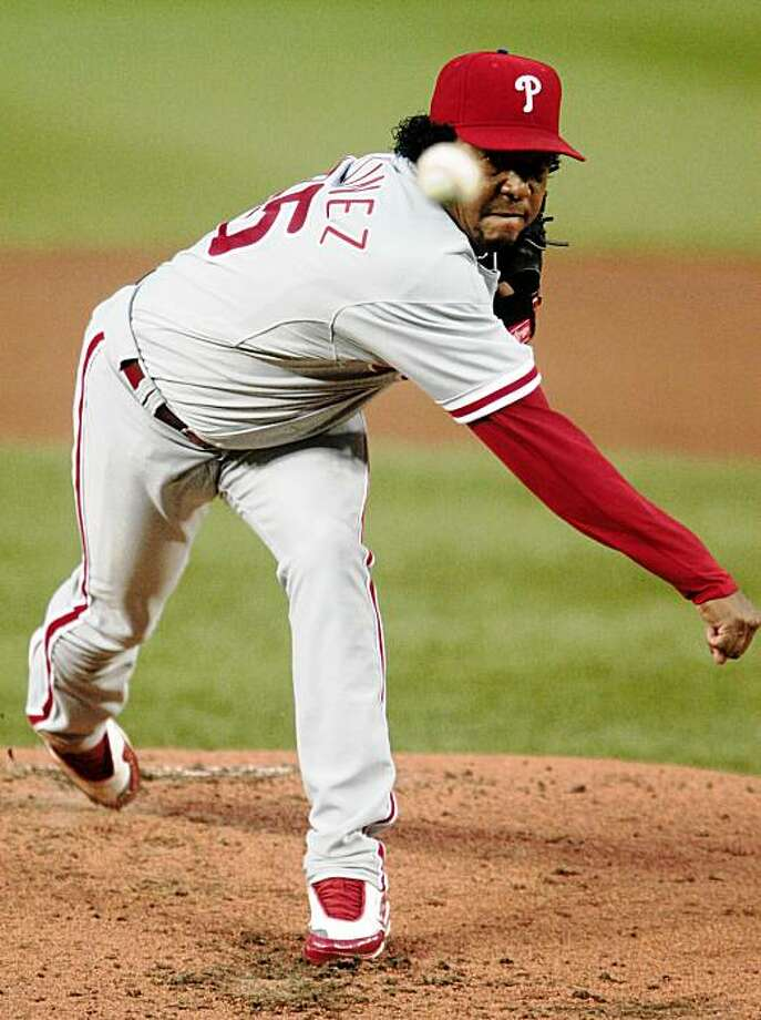 Philadelphia Phillies starting pitcher Pedro Martinez (45) delivers against the Washington Nationals in the first inning of a baseball game  in Washington, Tuesday, Sept. 8, 2009. (AP Photo/Pablo Martinez Monsivais) Photo: Pablo Martinez Monsivais, AP