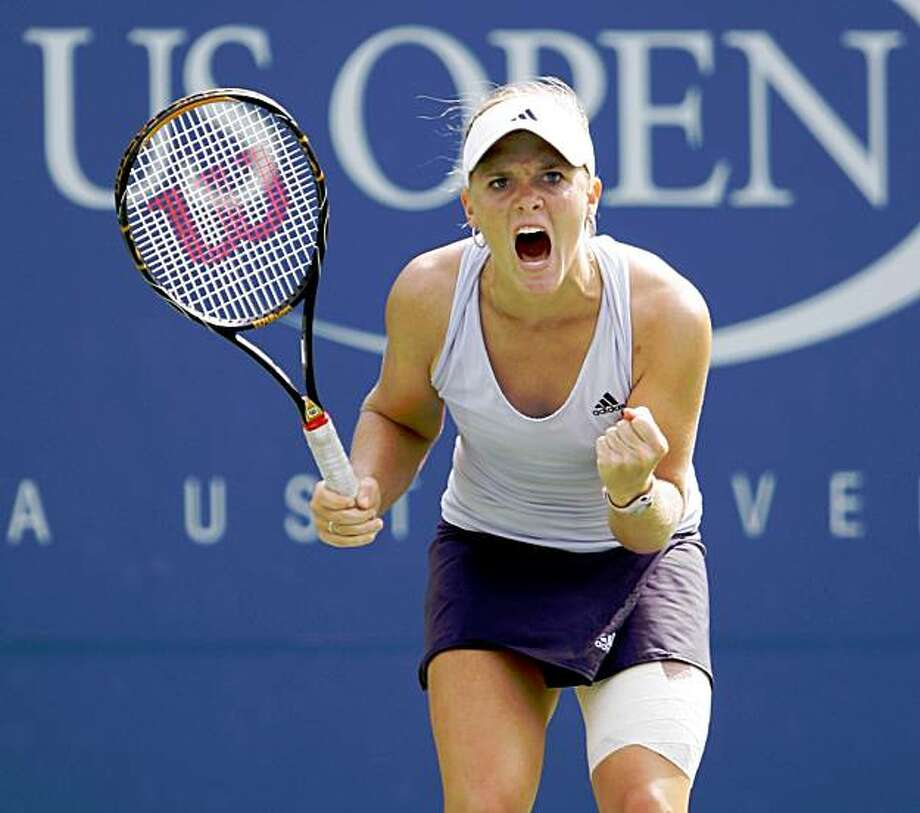 Melanie Oudin of the United States reacts during her match against Nadia Petrova of Russia at the U.S. Open tennis tournament in New York, Monday, Sept. 7, 2009. (AP Photo/Amy Sancetta) Photo: Amy Sancetta, AP