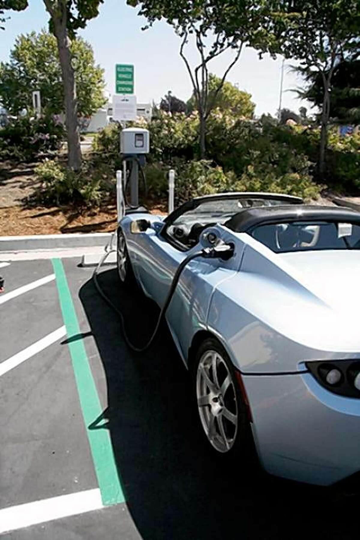 """This is a Tesla electric car using one of the charging stations along a """"charging corridor"""" between San Francisco and Los Angeles that Rabobank unveiled Tuesday, Sept. 23, 2009."""
