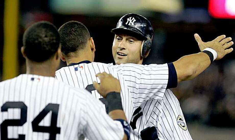 New York Yankees' Derek Jeter, right, celebrates with teammates Alex Rodriguez and Robinson Cano, left, after hitting a single during the third inning of a baseball game against the Baltimore Orioles to pass Lou Gehrig's all time Yankees hit record Friday, Sept. 11, 2009,  in New York.  (AP Photo/Frank Franklin II) Photo: Frank Franklin II, AP