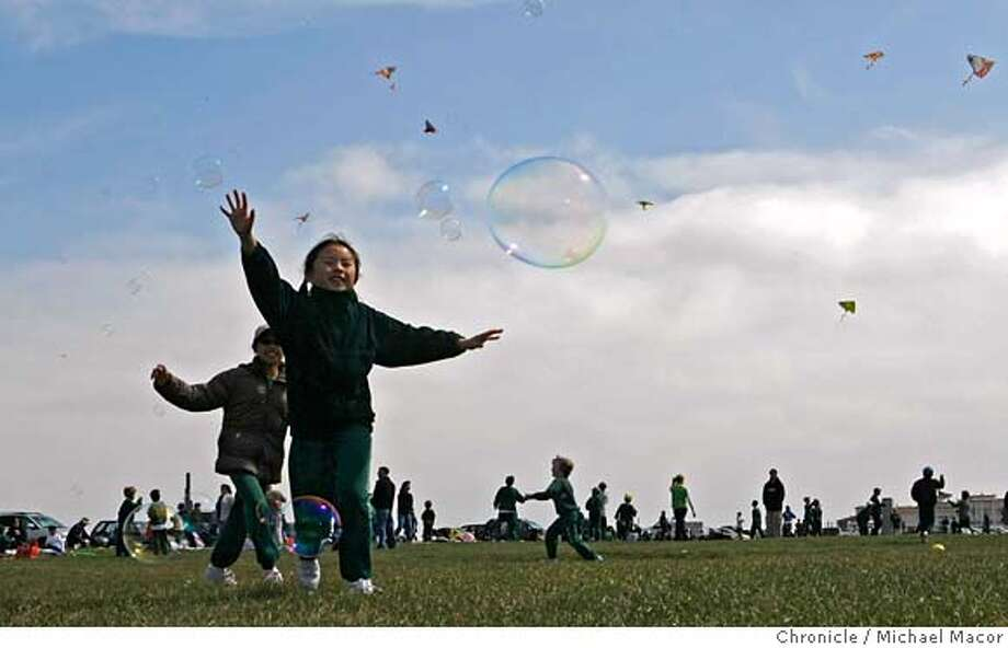 ###Live Caption:Adaline Wong, front and her friend Caitlin Jang, 4th garders at Salesian Catholic School of St. Peter and Paul Church in San Francsico, Calif. Chasing bubbles as kites fly all around during a day of fun at the Marina Green, along San Francisco Bay, on April 18, 2008. They are participating in a walk-a-thon event to raise funds for the school.  Photo by Michael Macor/ San Francisco Chronicle###Caption History:Adaline Wong, front and her friend Caitlin Jang, 4th garders at Salesian Catholic School of St. Peter and Paul Church in San Francsico, Calif. Chasing bubbles as kites fly all around during a day of fun at the Marina Green, along San Francisco Bay, on April 18, 2008. They are participating in a walk-a-thon event to raise funds for the school.  Photo by Michael Macor/ San Francisco Chronicle###Notes:School kids from the Salesian School of St. Peter and Paul Church in San Francsico, Calif. participated in a walk-a-thin event which included a day of fun at the Marina Green.###Special Instructions:Mandatory credit for Photographer and San Francisco Chronicle No sales/ Magazines Out Photo: Michael Macor