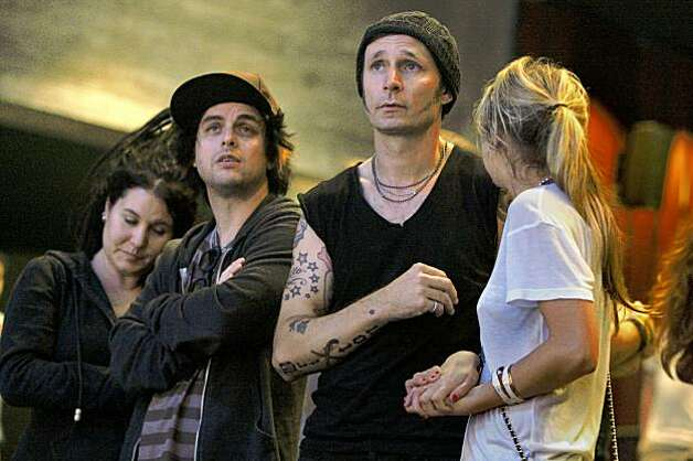"Billie Joe Armstrong (left) with his wife Adrienne Armstrong and Mike Dirnt with his wife Brittney Pritchard watching the ovation during the final dress rehearsal for Berkeley Rep's Roda Theatre world premiere of ""American Idiot, "" a new musical adaptation of Green Day's  album of same name, directed by Michael Mayer in Berkeley, Calif., on Thursday, September 3, 2009. Photo: Liz Hafalia, The Chronicle"