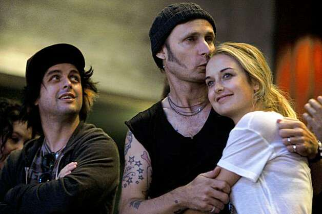"Billie Joe Armstrong (left) and Mike Dirnt with his wife Brittney Pritchard stand after watching the final dress rehearsal for Berkeley Rep's Roda Theatre world premiere of ""American Idiot, "" a new musical adaptation of Green Day's  album of same name, directed by Michael Mayer in Berkeley, Calif., on Thursday, September 3, 2009. Photo: Liz Hafalia, The Chronicle"