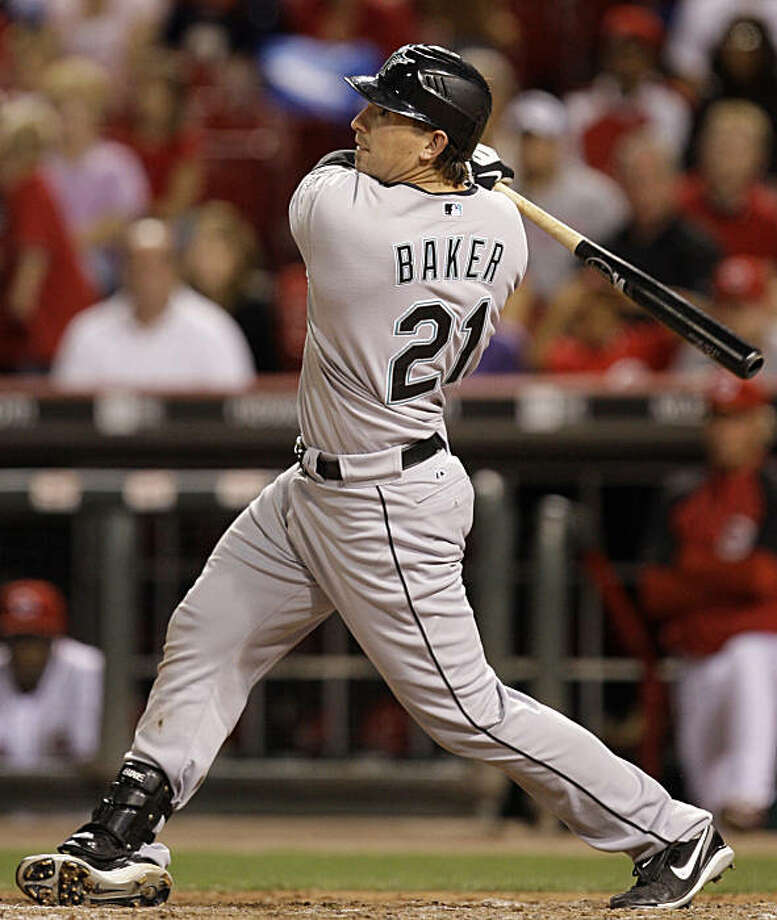 Florida Marlins' John Baker hits an RBI-single off Cincinnati Reds closer Francisco Cordero during the ninth inning of a baseball game, Friday, Sept. 18, 2009, in Cincinnati. Florida won the game 4-3. (AP Photo/Al Behrman) Photo: Al Behrman, AP