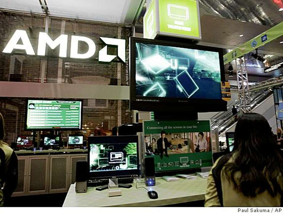 Advanced Micro Devices booth shown at the Consumer Electronics Shows in Las Vegas, Jan. 9, 2008. Advanced Micro Devices Inc. is expected to report first-quarter financial results after the market closes Thursday, April 17, 2008. (AP Photo/Paul Sakuma) Photo: Paul Sakuma, AP