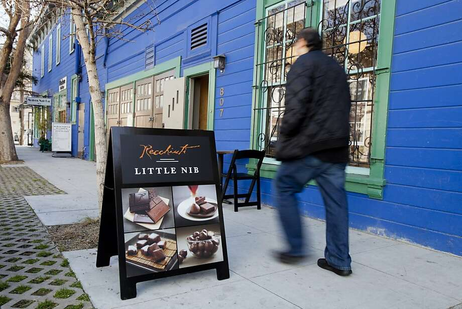A pedestrian walks pasts Recchiuti's Pop-up Store Little Nib in San Francisco, Calif. on Friday, Feb. 3, 2012. Photo: Stephen Lam, Special To The Chronicle